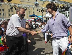 Liberal leader Justin Trudeau (R) shakes hands with New Democrat Party leader Thomas Mulcair before the gay pride parade in Toronto, June 30, 2013. REUTERS/Mark Blinch