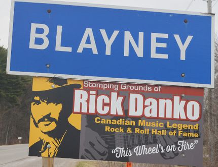 The sign honouring musician Rick Danko appears below the Blayney sign when travelling eastbound towards the community. The same sign was removed from the Blayney sign heading in from Bill's Corners.