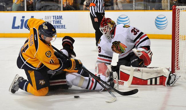 Predators' Ryan Ellis crashes towards Blackhawks goalie Scott Darling during Game 1 in Nashville on Wednesday. Darling made 42 saves in relief of Corey Crawford, who starts on Friday. (AFP/PHOTO)