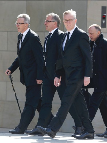 Lufthansa Chief Executive Carsten Spohr (2L) and Germanwings Managing Director Thomas Winkelmann (3L) arrive for a memorial service commemorating the 150 victims of Germanwings flight 4U 9525 in Cologne's Cathedral April 17, 2015. Germany holds a state ceremony at Cologne cathedral to remember the dead killed in the March 24 Germanwings plane crash in the French Alps. The person at left is unidentified.       REUTERS/Wolfgang Rattay