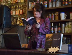 Erika Knudsen reads an excerpt from her latest book, Darkness, to a thrilled audience at Perks Coffee Shop in Spruce Grove on April 11. The horror novelist is on her fifth book and shows no signs of slowing down. - April Hudson, Reporter/Examiner