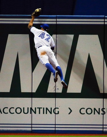 """What a catch! For both Blue Jays fielder Kevin Pillar and for Toronto Sun photographer Stan Behal, who managed to hit his shutter at the perfect time to capture the moment Wednesday. """"I saw Kevin Pillar sprint for the back and swung my lens to follow him as he crouched on the run to leap,"""" Behal recalls. """"As the first base umpire ran in front of my view to get a clearer look, I fired a burst in the hope that I would get something."""" Blowing up the frame, Behal saw the ball in the tip of Pillar's glove and knew he had his shot.  Your browser does not support iframes."""