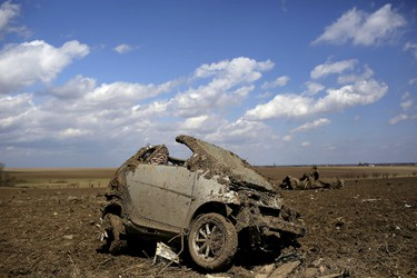 A Smart car destroyed by a tornado sits in a field in Rochelle, Ill., April 10, 2015. At least two people were killed and 20 injured when a tornado ripped through a small northern Illinois town on Thursday night, Illinois Governor Bruce Rauner said on Friday. (REUTERS/Joshua Lott)
