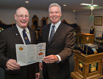 Harold McComb (left), president of the Brantford Scottish Rite Association, and Bert Barker review the program for the association's upcoming 100th anniversary at the Masonic Temple on Charing Cross Street. (Brian Thompson / The Expositor)