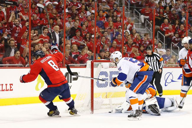 Washington Capitals left winger Alex Ovechkin scores a goal on New York Islanders goalie Jaroslav Halak in Game 2 of the first round of the 2015 NHL playoffs at Verizon Center on April 17, 2015. (Geoff Burke/USA TODAY Sports)