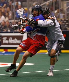 Kevin Crowley of the Rock (left) gets wrapped up by New England Black Wolves' Mike Manley on Friday night at the ACC. (JACK BOLAND/TORONTO SUN)