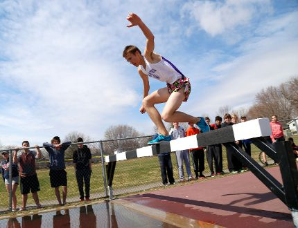 Declan Colwell of Thousand Islands Secondary School catches his balaqnce in the open men's steeplechase during the first track and field event of the season, the TISS Pirates Relays, on Friday. (DARCY CHEEK/The Recorder and Times)