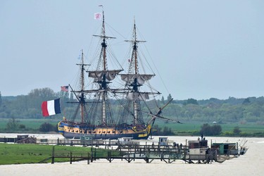 The replica of the French navy frigate L'Hermione, which played a key role in the American Revolution, and which will set sail on its maiden voyage to the United States is seen on the Chareente river in Rochefort, southwestern France, on April 18, 2015. The replica of the French navy frigate Hermione which brought General Lafayette to America to rally rebels fighting Britain in the US war of independence, will set sail for the United States again, 235 years after the original crossing. L'Hermione will leave its mooring on the island of Aix in the west of France, navigate up the Charente river to the naval town of Rochefort to pay homage to its birthplace, and finally head back to Aix before heading West. AFP PHOTO / XAVIER LEOTY