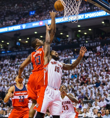 Toronto Raptors Amir Johnson and Washington Wizards Kevin Seraphin in Game 1 during 1st half playoff  action at the Air Canada Centre in Toronto, Ont. on Saturday April 18, 2015. Ernest Doroszuk/Toronto Sun/Postmedia Network