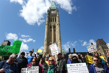 Protestors gather on Parliament Hill on Saturday afternoon, April 18, 2015. The demonstration was in protest to Bill C-51, the conservatives' anti-terror legislation. Andrew Meade/Ottawa Sun/Postmedia Network