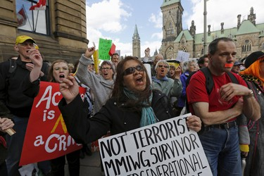 People take part in a demonstration against Bill C-51, the Canadian government's proposed anti-terror legislation, in Ottawa April 18, 2015. REUTERS/Chris Wattie