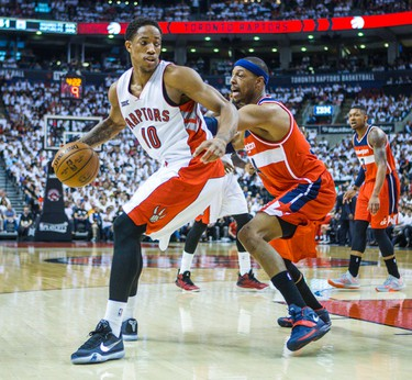 Toronto Raptors DeMar DeRozan and Washington Wizards Paul Pierce in Game 1 during 2nd half playoff  action at the Air Canada Centre in Toronto, Ont. on Saturday April 18, 2015. Ernest Doroszuk/Toronto Sun/Postmedia Network