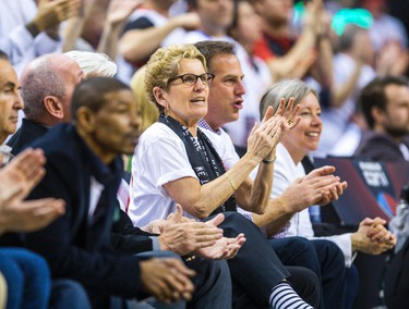 Ontario Premier Kathleen Wynne courtside watching the Toronto Raptors and Washington Wizards in Game 1 during 2nd half playoff  action at the Air Canada Centre in Toronto, Ont. on Saturday April 18, 2015. Ernest Doroszuk/Toronto Sun/Postmedia Network