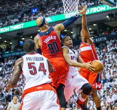 Toronto Raptors Kyle Lowry and Washington Wizards Drew Gooden and Kevin Pierce in Game 1 during 2nd half playoff  action at the Air Canada Centre in Toronto, Ont. on Saturday April 18, 2015. Ernest Doroszuk/Toronto Sun/Postmedia Network