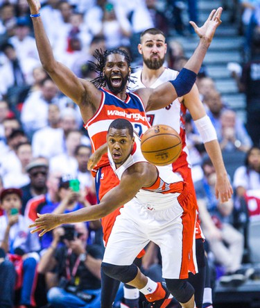Toronto Raptors Kyle Lowry and Washington Wizards Nene Hilario in Game 1 during 2nd half playoff  action at the Air Canada Centre in Toronto, Ont. on Saturday April 18, 2015. Ernest Doroszuk/Toronto Sun/Postmedia Network