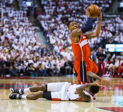 Toronto Raptors Lou Williams  and Washington Wizards Bradley Beal in Game 1 during 1st half playoff  action at the Air Canada Centre in Toronto, Ont. on Saturday April 18, 2015. Ernest Doroszuk/Toronto Sun/Postmedia Network