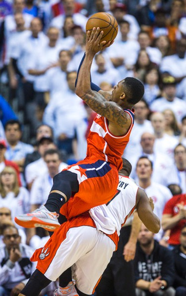 Toronto Raptors Kyle Lowry and Washington Wizards Bradley Beal in Game 1 during 2nd half playoff  action at the Air Canada Centre in Toronto, Ont. on Saturday April 18, 2015. Ernest Doroszuk/Toronto Sun/Postmedia Network