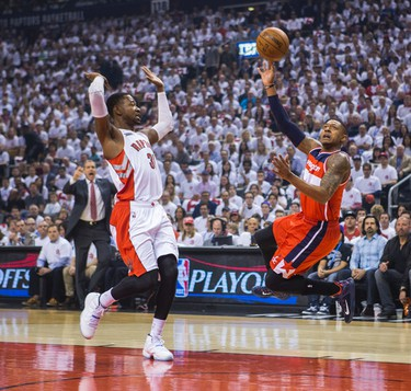 Toronto Raptors Terrence Ross and Washington Wizards Bradley Beal in Game 1 during 1st half playoff  action  at the Air Canada Centre in Toronto, Ont. on Saturday April 18, 2015. Ernest Doroszuk/Toronto Sun/Postmedia Network