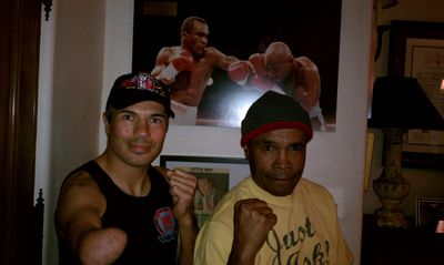 Winnipeg-raised Baxter Humby (left),  known as The One Armed Bandit and shown here with Sugar Ray Leonard, will be honoured at the High Stakes Havoc professional boxing event. The card is slated for April 30 at Club Regent Casino and Event Centre.