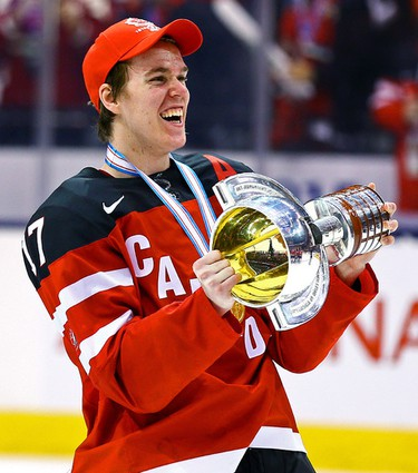 Connor McDavid raises the trophy as of Team Canada celebrates the win over Team Russia during the Gold Medal game of 2015 World Junior Hockey Championships at the Air Canada Centre in Toronto on Monday January 5, 2015. Dave Abel/Toronto Sun/QMI Agency