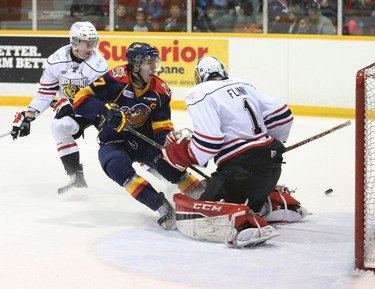 Erie Otters' Connor McDavid skids into Owen Sound Attack's goalie Jack Flinn after failing to score on a breakaway during the first period of Ontario Hockey League action at theHarry Lumley Bayshore Community Centre in Owen Sound, Ont., at the Lumley Bayshore in Owen Sound, Ont. on Friday, February 27, 2015. At left is Owen Sound Attack's Damir Sharipzyanov. James Masters/Owen Sound Sun Times/QMI Agency