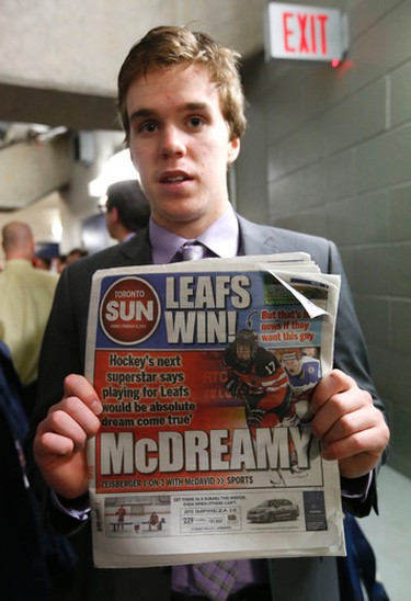 Connor McDavid holding a recent issue of the Toronto Sun  after the Erie Otters beat the Mississauga Steelheads 4-0 at Hershey Centre in Toronto on Monday February 16, 2015. Michael Peake/Toronto Sun/QMI Agency