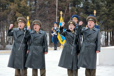 Military personnel cheer during a visit by North Korean leader Kim Jong Un to Korean People's Army pilots who have completed a tour of battle sites in the area of Mt Paektu, in this undated photo released by North Korea's Korean Central News Agency (KCNA) on April 19, 2015. REUTERS/KCNA