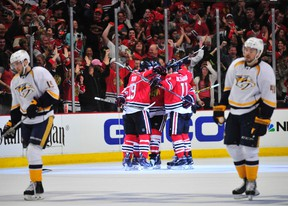 The Chicago Blackhawks celebrate a goal during the second period in game three of the first round of the 2015 Stanley Cup Playoffs at the United Center. (David Banks-USA TODAY Sports)