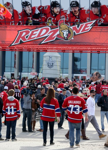 Ottawa Senators and Montreal Canadiens fans enjoy the festivities before game three outside of the Canadian Tire Centre in Ottawa Sunday April 19, 2015. Tony Caldwell/Postmedia Network
