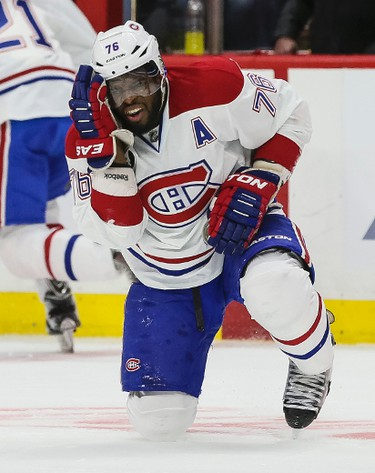 Montreal Canadiens P.K. Subban holds his head after he was hit with a stick in play against the Ottawa Senators during NHL hockey action at the Canadian Tire Centre in Ottawa, Ontario on April 19, 2015. Errol McGihon/Ottawa Sun/QMI Agency