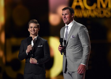 Singer Hunter Hayes (L) and professional football player Jason Witten speak onstage during the 50th Academy Of Country Music Awards at AT&T Stadium on April 19, 2015 in Arlington, Texas.   Ethan Miller/Getty Images for dcp/AFP
