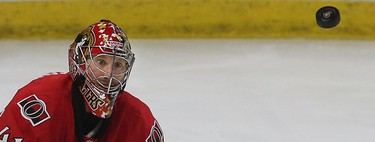 Ottawa Senators Craig Anderson looks for a Montreal Canadiens shot during overtime at the Canadian Tire Centre in Ottawa Sunday April 19, 2015. The Montreal Canadiens defeated the Senators 2-1 in overtime. Tony Caldwell/Postmedia Network