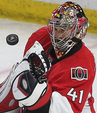 Ottawa Senators Craig Anderson makes a save against the Montreal Canadiens during third period action at the Canadian Tire Centre in Ottawa Sunday April 19, 2015. Tony Caldwell/Postmedia Network