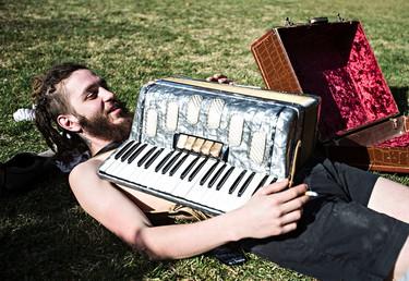 Tony Bonise rests with his accordion during 420 festivities at the Alberta Legislature Building in Edmonton, Alta. on Monday, April 20, 2015. Codie McLachlan/Edmonton Sun/Postmedia Network