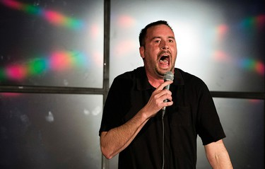 """Edmonton Sun video editor Nathan Martin performs a comedy routine during the launch for Cam Tait's book """"Disabled? HELL NO! I'm a Sit-Down Comic!"""", at The Comic Strip in West Edmonton Mall, in Edmonton, Alta. on Sunday April 19, 2014. David Bloom/Edmonton Sun/Postmedia Network"""