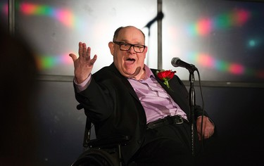"""Cam Tait tells jokes during the launch for his book """"Disabled? HELL NO! I'm a Sit-Down Comic!"""" at The Comic Strip in West Edmonton Mall, in Edmonton, Alta. on Sunday April 19, 2014. David Bloom/Edmonton Sun/Postmedia Network"""