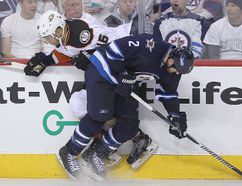 Anaheim Ducks left winger Emerson Etem (16) is taken out by Winnipeg Jets defenceman Adam Pardy during NHL playoff hockey in Winnipeg, Man. Monday, April 20, 2015. Brian Donogh/Winnipeg Sun/Postmedia Network