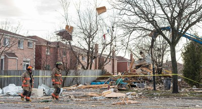 Only rubble remains a firefighters walk past  the scene of a  reported house collapse on Brimley Rd, south of Steeles Ave E in Toronto, Ont. on Monday April 20, 2015. Ernest Doroszuk/Toronto Sun/Postmedia Network