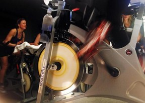 The wheels of an indoor bicycle are seen spinning at a SoulCycle class at their Union Square location in New York April 13, 2011. (Reuters/Shannon Stapleton)