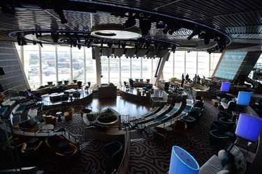 The 'Two70' lounge on the Royal Caribbean's latest cruise liner 'The Anthem Of The Seas', a 4,905-passenger ship which is docked in Southampton on April 20, 2015. The ship is billed as the most technologically advanced cruise vessel ever. It boasts fast internet speeds, an all-digital check-in process, a skydiving simulator at sea and the first bumper cars at sea. AFP PHOTO / GLYN KIRK