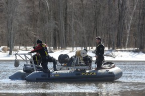 A Surete du Quebec dive team searches the Ottawa river behind the Abitibi Bowater paper mill in Gatineau, Quebec.on Apr. 7, 2015. Two teenage boys fell into the water in the area the night of Apr. 6 but one remains missing. (Andrew Meade/ Ottawa Sun)