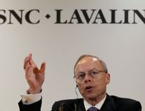 Robert G. Card, president and chief executive officer of SNC-Lavalin gestures during a news conference following their annual general meeting in Montreal, May 8, 2014. REUTERS/Christinne Muschi