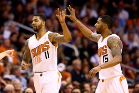 Phoenix Suns forward Markieff Morris (left) celebrates a play with twin brother Marcus against the Indiana Pacers at US Airways Center. (Mark J. Rebilas/USA TODAY Sports)
