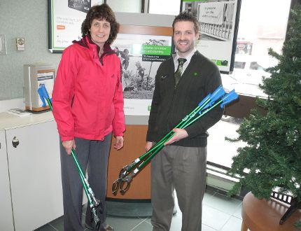 Kenora's Adopt-a-Block coordinator Arleen Wilcox accepts five litter pickers from Toronto Dominion Bank Kenora branch manager James Foster donated by staff in support of the TD Friends of the Environment Foundation. The pickers are available on loan to residents participating in Adopt-a-Block or Green Leaf neighbourhood clean-up campaigns by contacting Wilcox at city hall 467-2000. REG CLAYTON/Miner and News