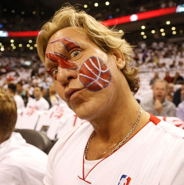 Dragons Den's Michael Wekerle is the ultimate fan on the sidelines in the first half of the Raptors-Washington Wizards game on April 21. (Jack Boland/Toronto Sun/Postmedia Network)