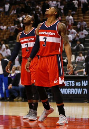 John Wall (left) and Bradley Beal of the Washington Wizards watch the seconds tick down on the clock in the second half at the Air Canada Centre on Tuesday night. (Jack Boland/Toronto Sun)