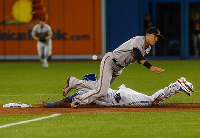 Toronto Blue Jays, Jose Reyes, slides into second and makes it to third, vs. Baltimore Orioles, at the ACC in Toronto, Ont. on Tuesday April 21, 2015. Dave Thomas/Toronto Sun
