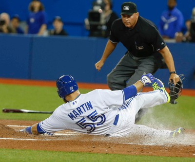 Toronto Blue Jays, Russel Martin, slides home safe, vs. Baltimore Orioles, at the ACC in Toronto, Ont. on Tuesday April 21, 2015. Dave Thomas/Toronto Sun