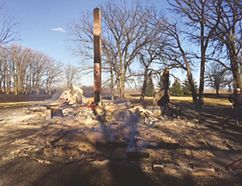 The ashes were still smoldering on Tuesday morning, following a fire on April 13 at a rural property in the R.M. of Rhineland, near Halbstadt. The chimney is all that remains of the home.