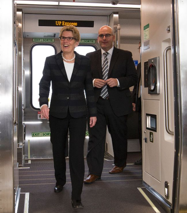 Premier Kathleen Wynne and Steven Del Duca, minister of Transportation, ride the new UP Express from Union Station to Pearson airport Wednesday, April 22, 2015. (Craig Robertson/Toronto Sun)